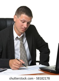 The businessman on the workplace. It is isolated on a white background