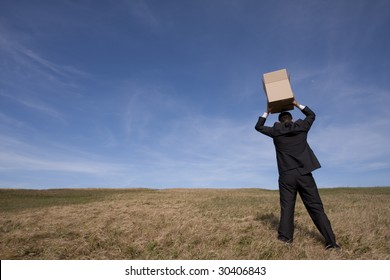 businessman with an open box at the field