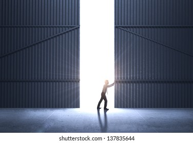 businessman open gate  and sunlight