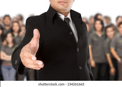 Businessman with  open hand ready to seal a deal