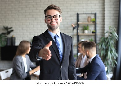 Businessman with an open hand ready to seal a deal