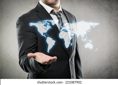 Businessman with open palm showing world map. Concept of worldwide trade and ecommerce.