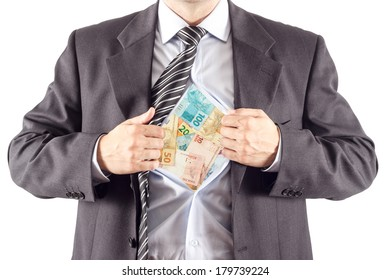 Businessman opening his shirt and showing brazilian money isolated on white