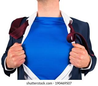Businessman opening his shirt superhero style on white background