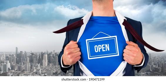Businessman opening his shirt superhero style against balcony overlooking city