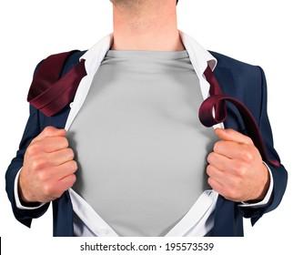 Businessman opening shirt in superhero style on white background