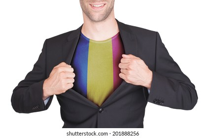 Businessman opening suit to reveal shirt with flag, Romania