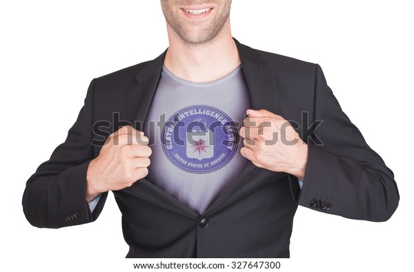 Businessman opening suit to reveal shirt with flag, CIA