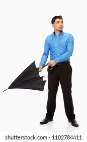 Businessman opening up an umbrella