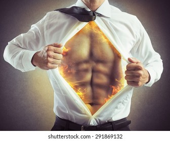 Businessman opens shirt with abs of fire