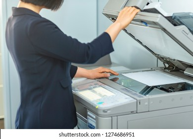 A businessman operating a copy machine