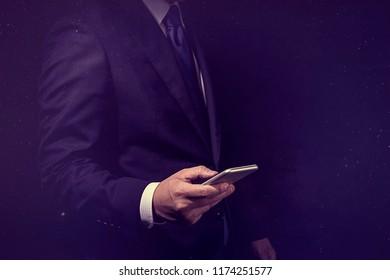 Businessman operating a smartphone.