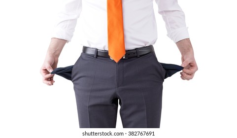 businessman with an orange tie turning his empty pockets inside out. Front view, no head. Isolated. Concept of bankruptcy.