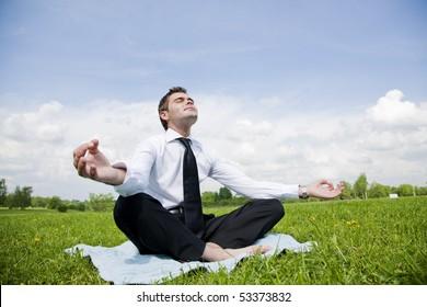 businessman outdoor do yoga exercise