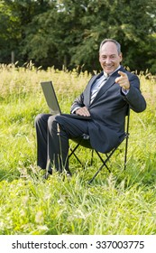 Businessman outdoor on meadow