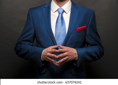 Businessman over dark background. Suit and tie.