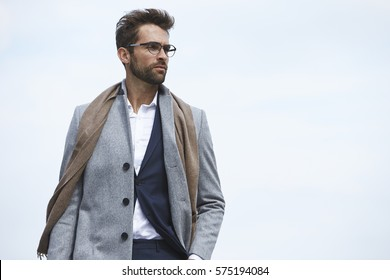 Businessman in overcoat, looking away