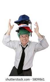 Businessman overwhelmed by too many responsibilities - symbolized by wearing too many hats.  Isolated on white.
