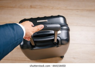 businessman packed up and sent on a business trip with a suitcase in another country