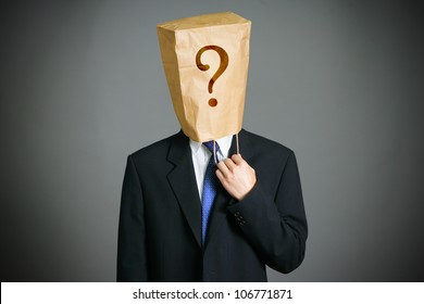 Businessman with a paper bag  on head