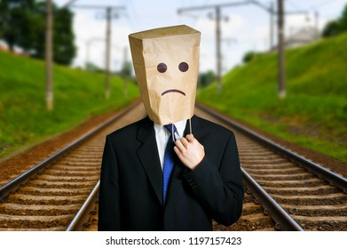 Businessman with paper bag on the head