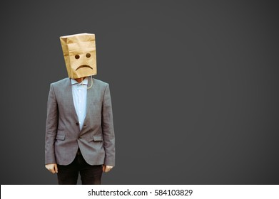 businessman with paper bag on the head.