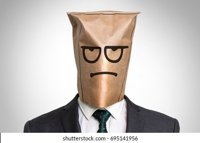 Businessman with a paper bag on the head - with sad face
