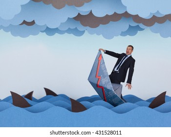 Businessman and paper boat is sinking into paper sea. Paper waves, clouds, boat and sharks.