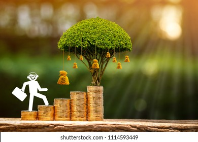Businessman with paper cut running up and climb the stacking gold coin and money bag of tree with growing as destinations on sunlight in public park, Investment and business competition concept.