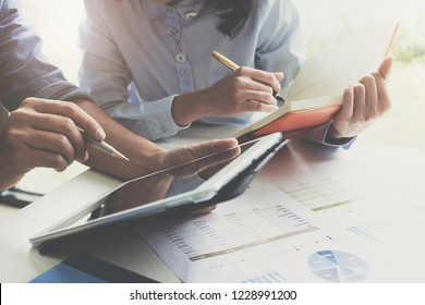 Businessman and partner hand using digital tablet and making presentation business strategy.