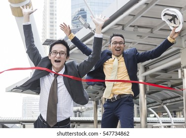 Businessman and partner Winning crosses the finish line,Businessman running into finish line achieving accomplishment