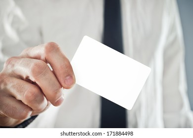 Businessman paying with credit card, selective focus. Blank credit card with copy space for any title or design.