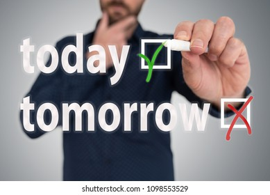 businessman with pen choosing between today and tomorrow anti procrastination concept