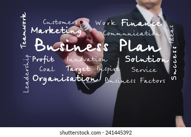 businessman with pen writing on the screen.Business Factors