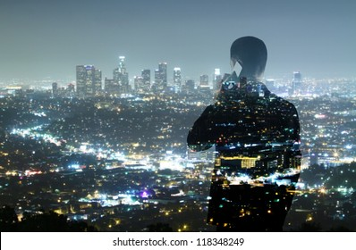 businessman with phone looking in night city