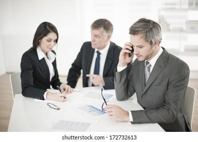 Businessman at phone in meeting