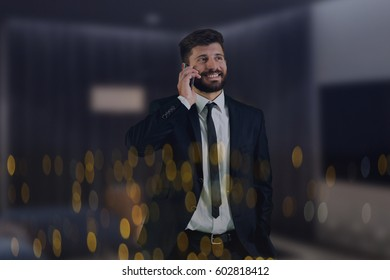The businessman phone near the window with city lights