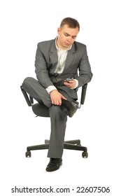 businessman with phone on chair