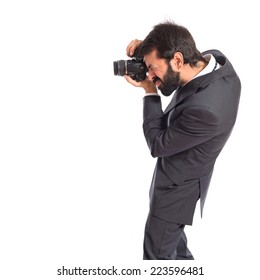 Businessman photographing over white background