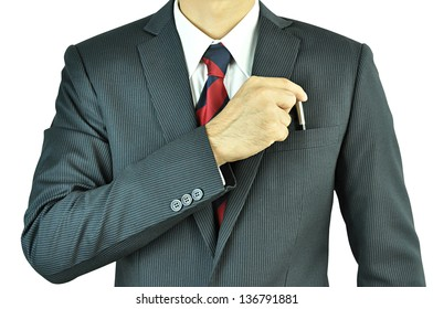 Businessman picking a pen from the pocket