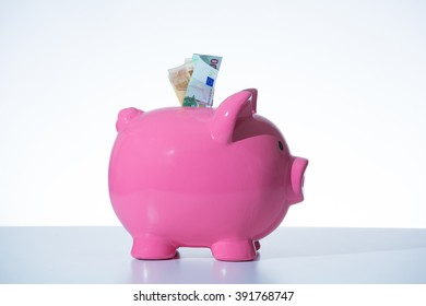 businessman with pink moneybox