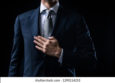 Businessman is place your hand on the chest