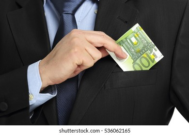 businessman placing euro banknote in his pocket