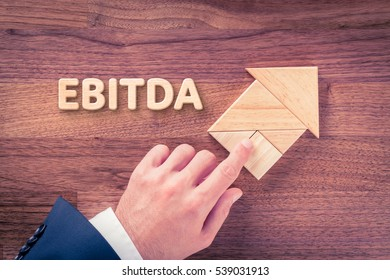 Businessman plan EBITDA growth represented by arrow.
