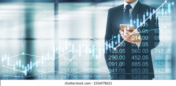 Businessman plan graph growth and increase of chart positive indicators in his business.smartphone in hand