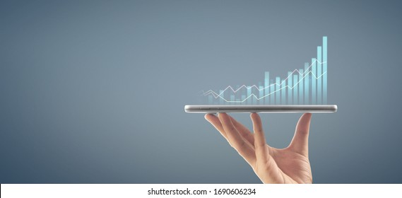 Businessman plan graph growth and increase of chart positive indicators in his business,tablet in hand