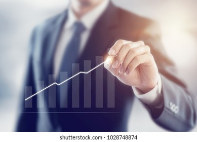 Businessman plan growth and increase of positive indicators in his business, Development and growth concept.