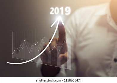 Businessman plan growth and increase of positive indicators in his business. Business growth concept year 2019