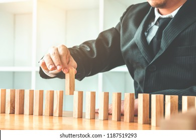 Businessman plan and strategy in business Domino Effect Leadership Management Solution concept