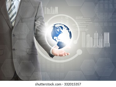 Businessman with planet in hand on abstract background